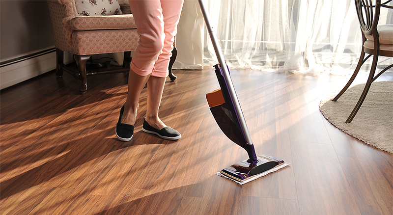 Woman cleaning her floors