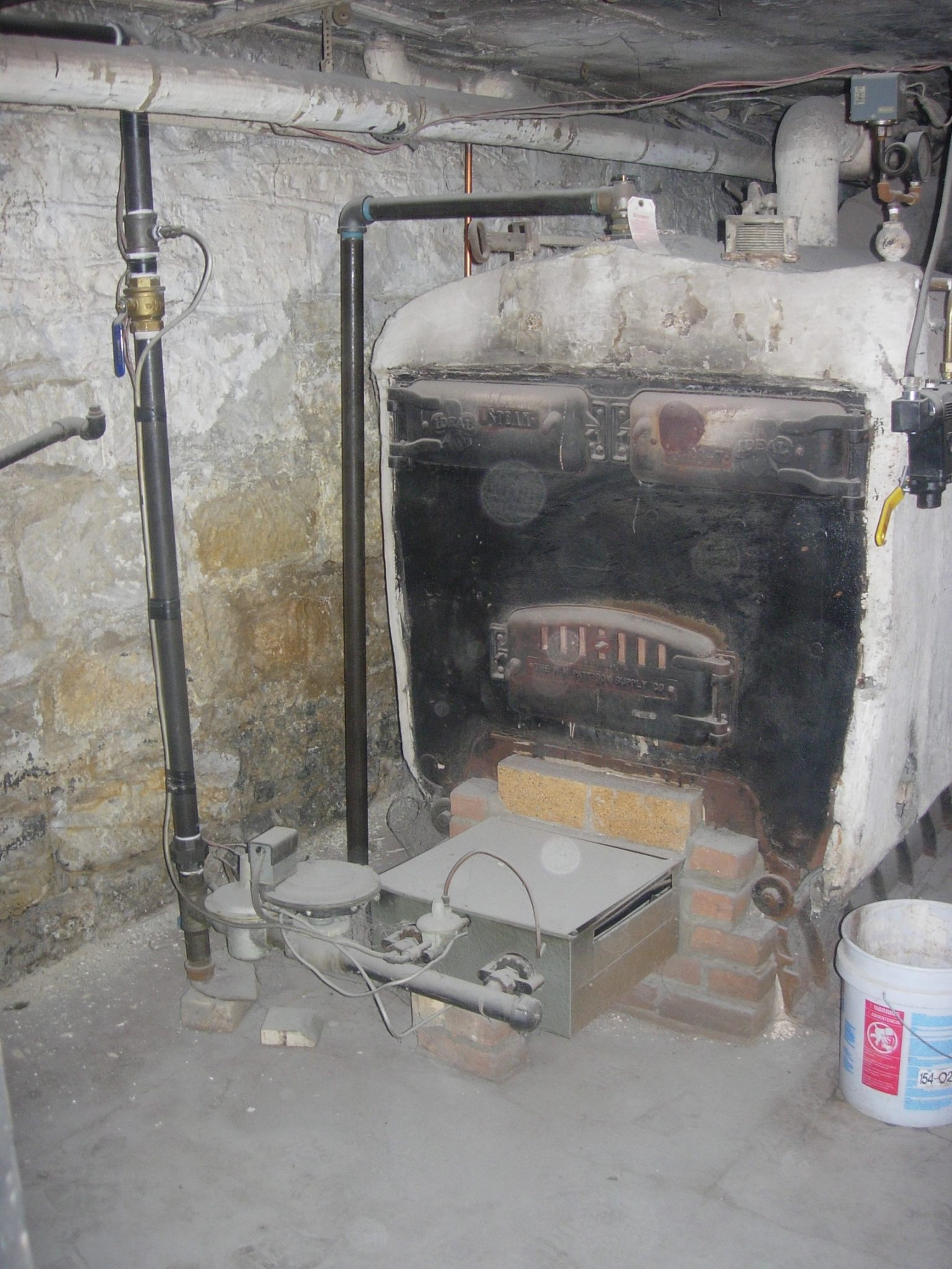Old boiler in basement of house