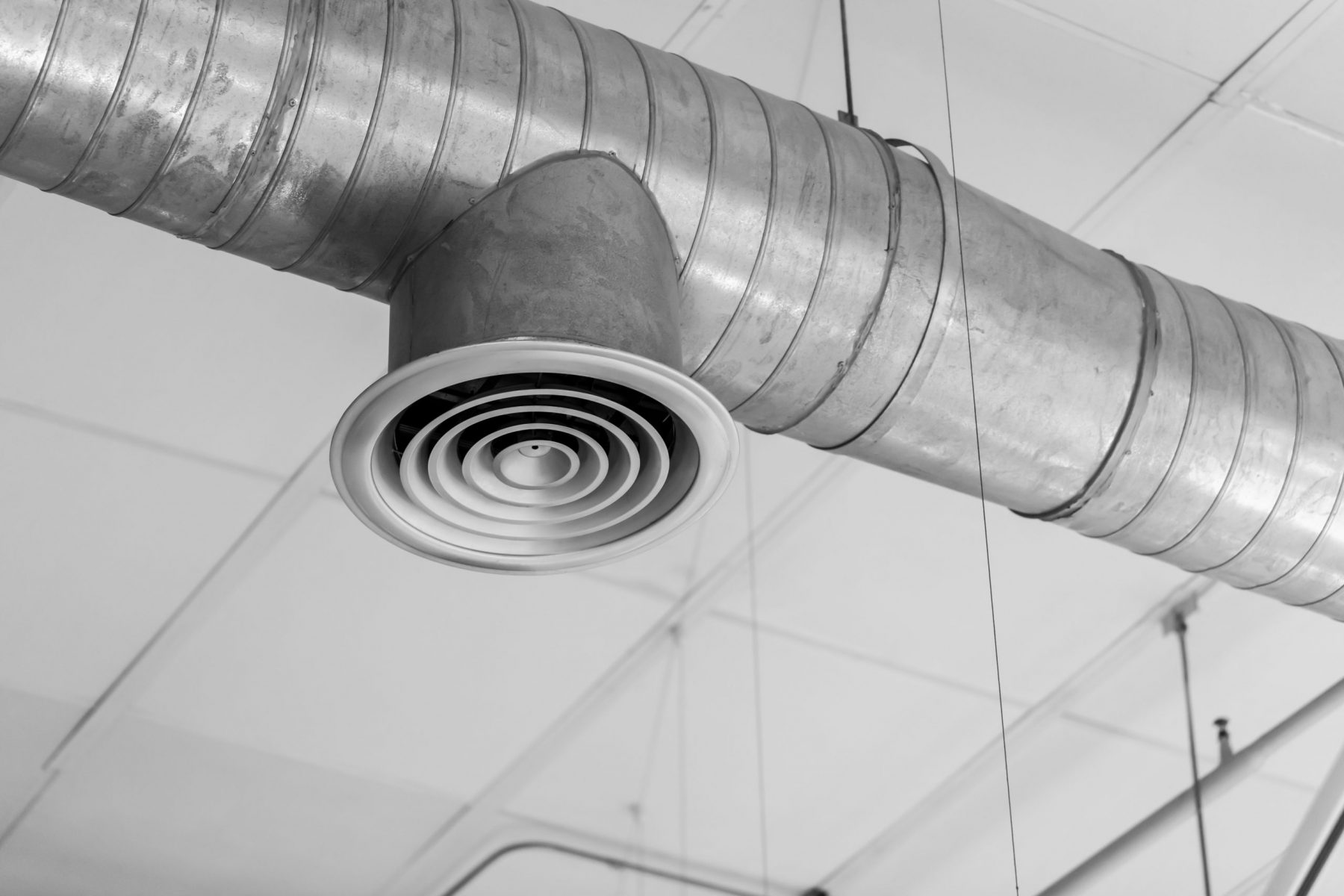 Air duct with vent hanging from ceiling