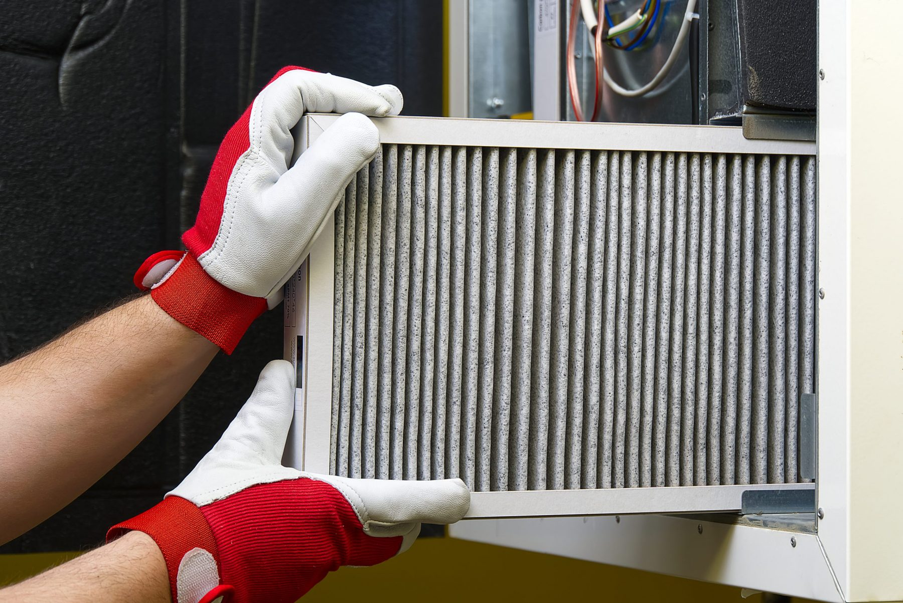 Replacing the filter in the central ventilation system.